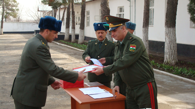 Graduation ceremony for newly examinated border guards outside the IOM built training centre for border guards in Dushanbe.